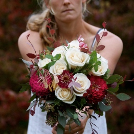 Megan holding the bridal bouquet.