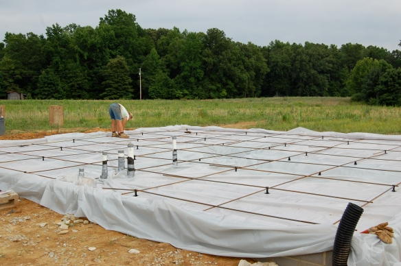 We installed a plastic vapor barrier and rebar to help strengthen the concrete