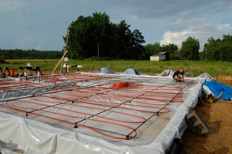installing the radiant floor heat red tubing