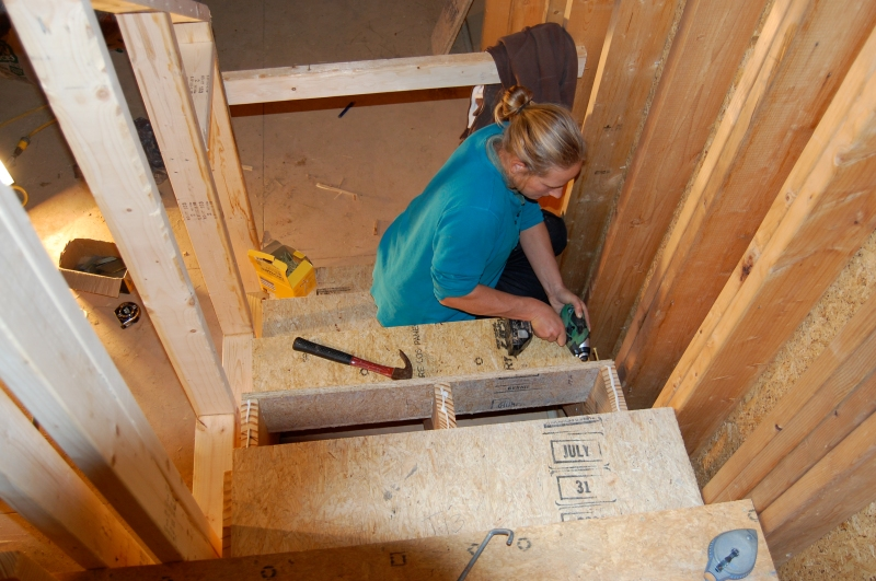 Megan installing stair treads and risers