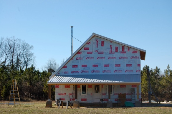 Our house with the roof on, mid-January 2015.