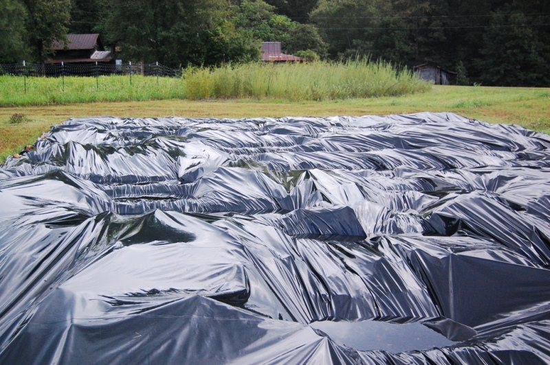 Occultation is a techniques that uses tarps to speed decomposition and build soil.